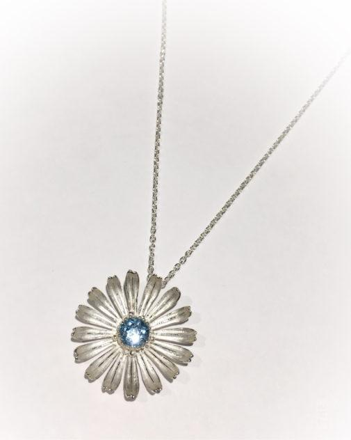 Large Silver Daisy Pendant & Chain with Blue Topaz by Kevin Cremin at The Avenue Gallery, a contemporary fine art gallery in Victoria, BC, Canada.