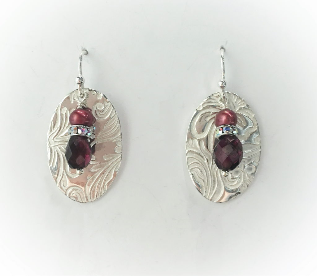 Oval Textured Earrings with Garnet & Pearl by Veronica Stewart at The Avenue Gallery, a contemporary fine art gallery in Victoria, BC, Canada.