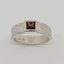 Silver Carved Tank Ring with Garnet by Kevin Cremin at The Avenue Gallery, a contemporary fine art gallery in Victoria, BC, Canada.