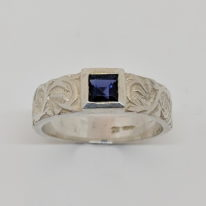 Silver Carved Tank Ring with Iolite by Kevin Cremin at The Avenue Gallery, a contemporary fine art gallery in Victoria, BC, Canada.