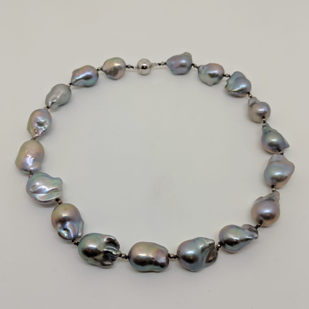 Grey Baroque Freshwater Pearl Necklace with Sterling Silver and Crystal Clasp by Val Nunns at The Avenue Gallery, a contemporary fine art gallery in Victoria, BC, Canada.