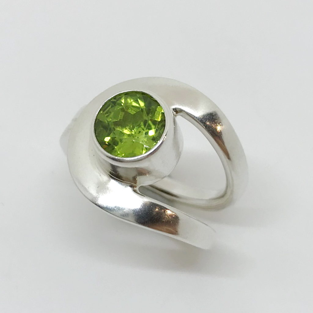 Buttonhole Ring with Peridot by A & R Jewellery at The Avenue Gallery, a contemporary fine art gallery in Victoria, BC, Canada.