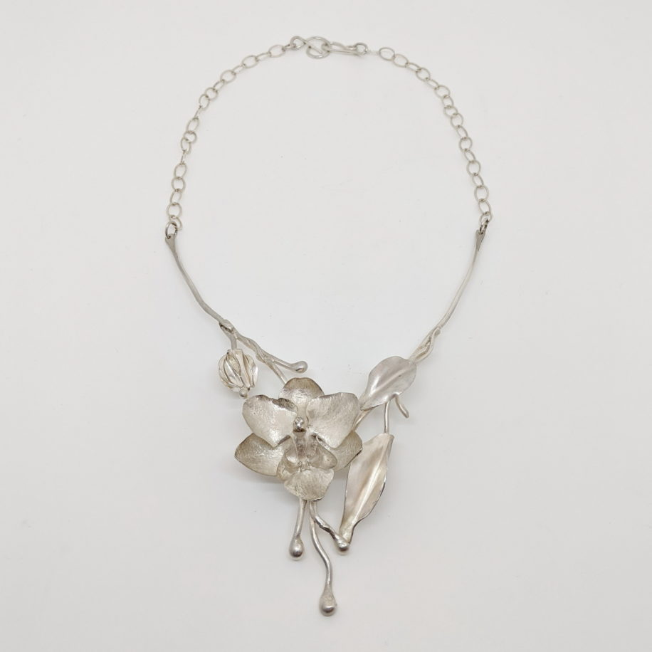 Argentium Silver Orchid Necklace by Darlene Letendre at The Avenue Gallery, a contemporary fine art gallery in Victoria, BC, Canada.