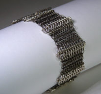 Titanium & Sterling Silver Urchin Bracelet by Anne Kelly at The Avenue Gallery, a contemporary fine art gallery in Victoria, BC, Canada.